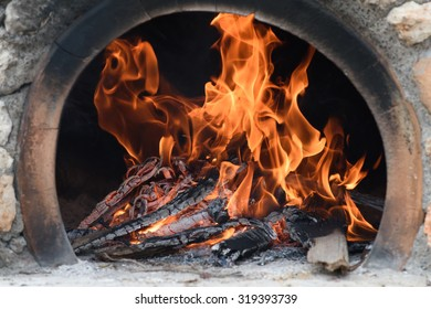 The fire of a traditional charcoal oven, Hersonisos, Crete.