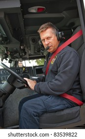 Fire Truck Driver with Headphone and Microphone on