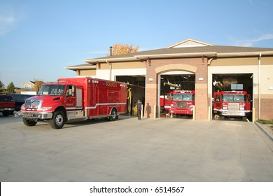 Fire truck in front of fire house