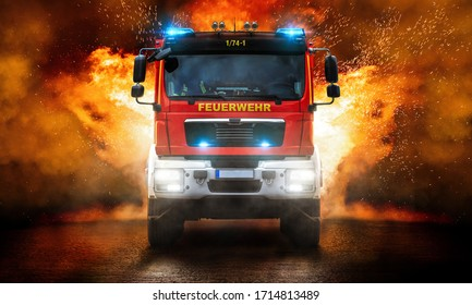 A fire truck in front of a wall of fire