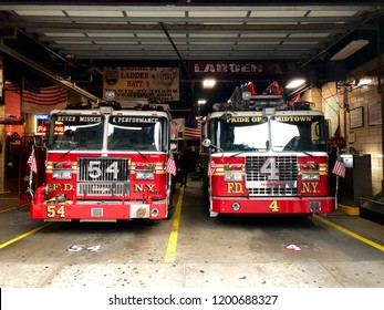 Fire truck in the parking lot in FDNY Engine 54 Ladder 4 Battalion 9 on 8th Avenue in Midtown New York, waiting for a call. F.D.N.Y. firetrucks parked inside a station. New York, USA 10/01/2018