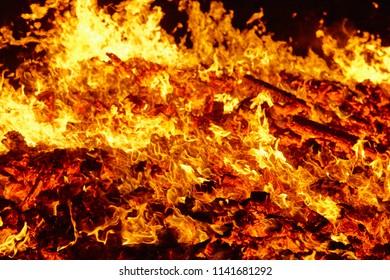 Fire. Volcano incandescent material. Hot charcoal bonfire. Carbon emissions combustion