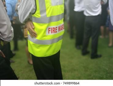 Fire warden man in the training of emergency fire drill