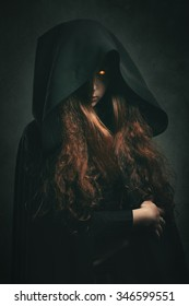 Fire witch with black robe . Dark fantasy portrait