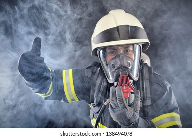 Fire woman in fire protection suit and mask