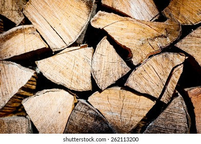 fire wood background texture. closeup of chopped fire wood stack