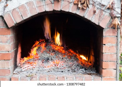 Fire wood burning in the oven. Close-up.