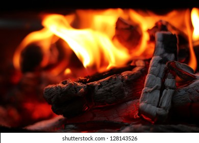 Fire wood coal amber ash closeup