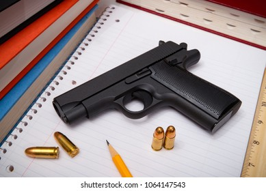Firearm and Bullets with Textbooks