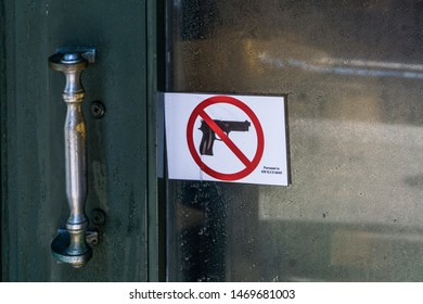 Firearm control in the gate of a bar