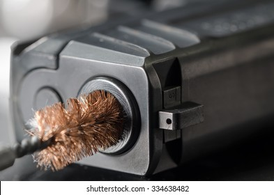 Firearm Maintenance - Brush Cleaning Bore of Gun