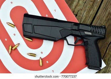 firearm sound suppressor on the target and wooden background