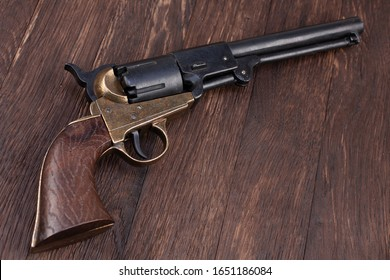 Firearms of the Old West - Percussion Army Revolver on wooden table