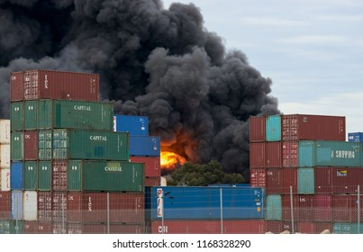 Fireball explosion at a West Footscray factory fire as seen from behind shipping containers. Melbourne, Victoria, Australia 30 August 2018.