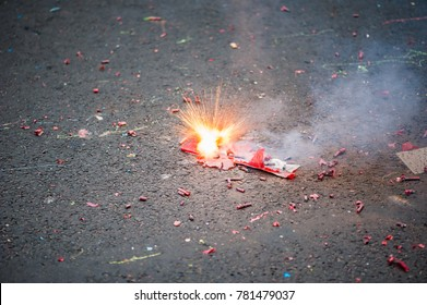 Firecracker exploding in the street for the chinese new year celebration