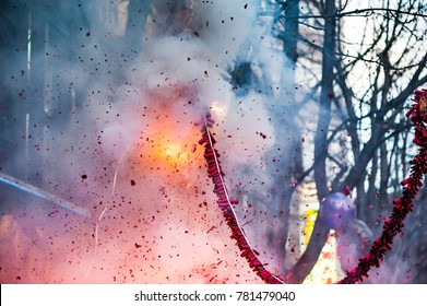 Firecrackers exploding in the street for the chinese new year celebration