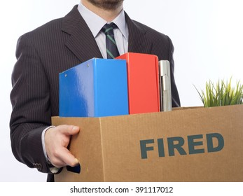 Fired businessman holding box with personal belongings isolated on white background.