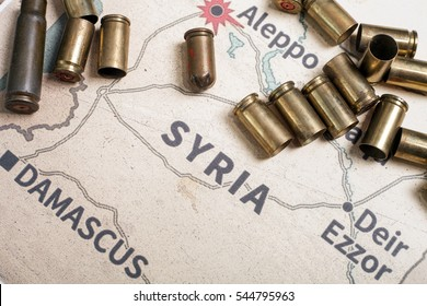 The fired cases with 9mm and bullets from kalashnikov. Background view on map of Aleppo, Syria. Konflikt in Syria. Stop war in Syria.