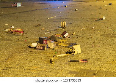 Fired New Year's Eve fireworks remains as a garbage back on the streets