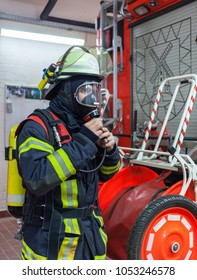 Firefighter in action and with oxygen bottle and mask - Serie Firefighter
