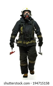 Firefighter with axes and wearing oxygen mask isolated on white
