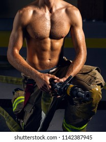 Firefighter body muscle holding fire hoses