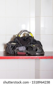 firefighter clothes and helmet on a shelf ready to dress
