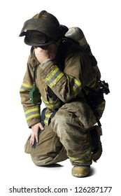 Firefighter crouching and sad