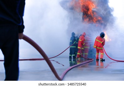 Firefighter demonstration use extinguisher water attacking fire Firefight in the industrial Factory training plant,brave rescue emergency situation teamwork against fire,wearing firefight safety suit