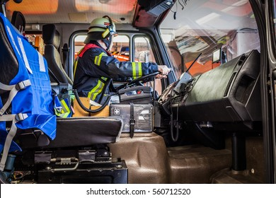 Firefighter drives a emergency vehicle with communication interior view - HDR