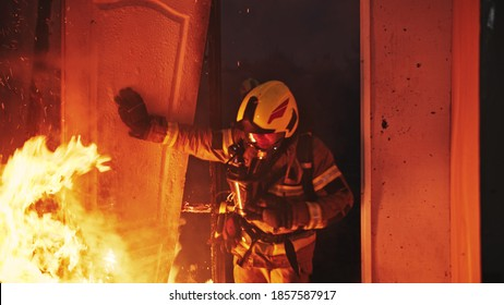 Firefighter entering through the door of the burning house. High quality photo