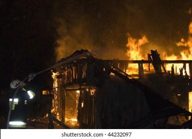 Firefighter extinguishes burning house