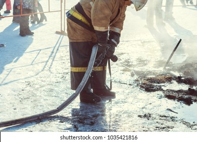 firefighter extinguishes with water
