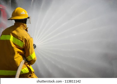 Firefighter fighting For A Fire Attack, During A Training Exercise