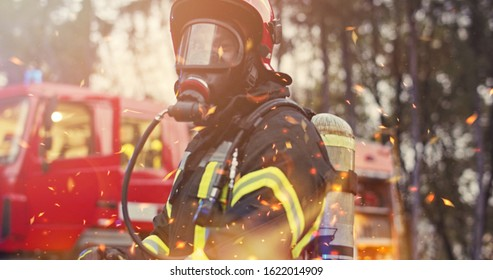 Firefighter in fire fighting operation, fireman in protective clothing and helmet with equipment in action fighting