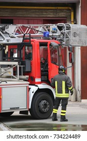 firefighter and fire truck in barracks during a firefighting exercise