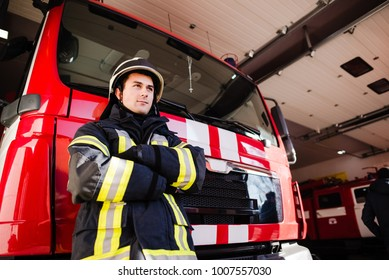 Firefighter, fireman. Emergency safety. Protection, rescue from danger. Fire fighter in protective helmet. Adult man, hero in equipment, uniform at work.