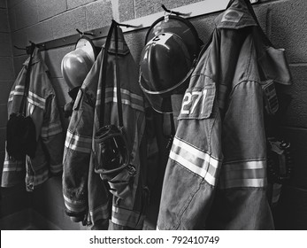 Firefighter gear with fire hoses and truck