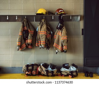 firefighter gear hanging in the firestation