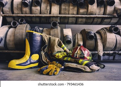 Firefighter gear with hoses background