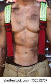 Firefighter gear sling on sexy body