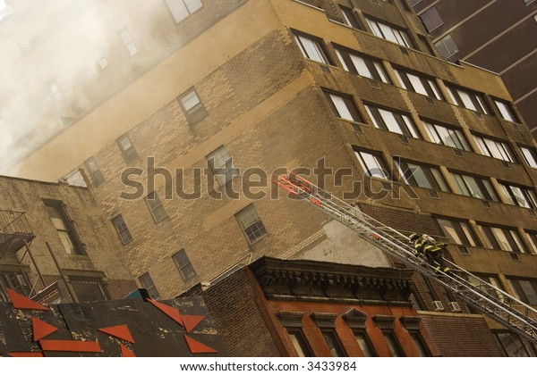 firefighter is going to extinguish fire on top of the building