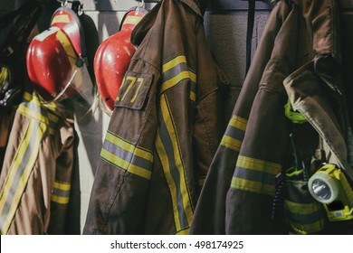 Firefighter hanging, ready for call