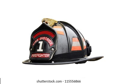 firefighter hat and leather badge isolated over a white background