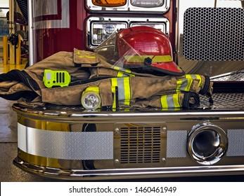 Firefighter helmet and gears on firetruck