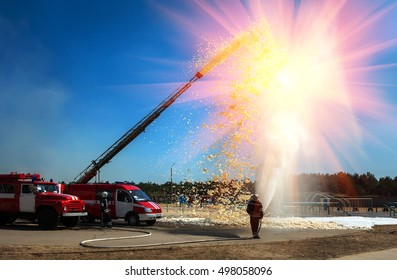 firefighter holding a fire hose with water pressure, a demonstration of fire fighting equipment.