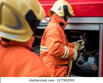 Firefighter holding hose