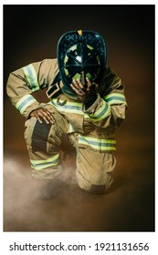 A firefighter kneeling after a long day