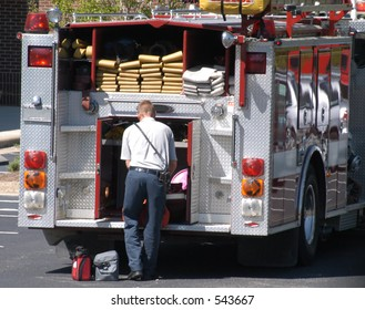Firefighter loading up truck after accident
