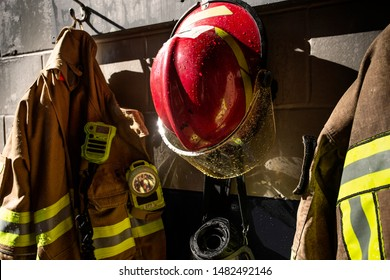 Firefighter protection clothes and helmet hanging in the fire station